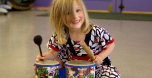 Child playing instrument